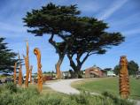 Apollo Bay / Foreshore Reserve in town centre, Great Ocean Road / Wood sculptures, view south along foreshore at Visitor Information Centre