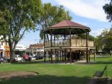 Bairnsdale / Commercial centre and shops / Rotunda, view west along Main St gardens from Bailey St