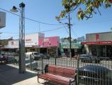 Belgrave / Shops and commercial centre, Main Street and Bayview Road / View north-east along Main St between pedestrian lights