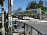Belgrave / Shops and commercial centre, Main Street and Bayview Road / View west across Main St at Gembrook Rd