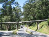 Belgrave / Puffing Billy viewing area, Gembrook Road at railway bridge / View east along Gembrook Rd towards bridge