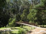 Blackwood / Mineral Springs Reserve at Lerderderg River, Golden Point Road / View along footbridge to mineral spring on other side of river