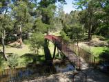 Blackwood / Mineral Springs Reserve at Lerderderg River, Golden Point Road / View along footbridge towards picnic areas and car park