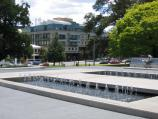 Carlton / Lincoln Square, between Swanston Street and Bouverie Street / Fountain, view west through Lincoln Square