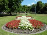 Dandenong / Dandenong Park, Foster Street and Pultney Street / View through park at flower bed towards soundshell