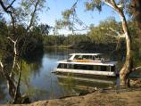 Echuca / Victoria Park, Scenic Drive and Murray River / A house boat moored on the Murray River, off Scenic Drive