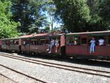 Emerald / Puffing Billy station in Emerald town centre / Travellers in carriages of Puffing Billy stopped at station
