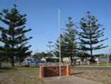 Golden Beach / Community Centre, Surf Edge Drive opposite Blue Water Avenue / Flag pole with Surf Edge Dr in background