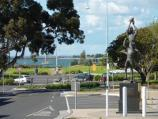 Hastings / Commercial centre and shops, High Street precinct / View east along High St at John Coleman statue towards Marine Pde and foreshore