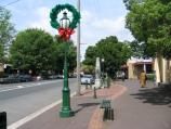 Healesville / Shops and commercial centre, Nicholson Street west of Badger Creek Road / Christmas decorations, view west along Nicholson St at community centre