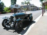 Kyneton / The historic Piper Street / Vintage car parked on Piper St, view east towards Ebden St