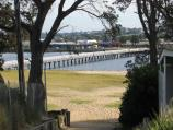 Lakes Entrance / Footbridge across Cunninghame Arm from the Esplanade to Main Beach / View north towards footbridge from path to Ninety Mile Beach