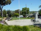 Lilydale / Shops and commercial centre, Main Street / Westerly view through gardens at war memorial towards Clarke St