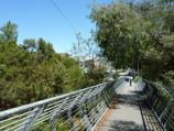 Lilydale / Shops and commercial centre, Main Street / View west along footbridge over Olinda Creek, south side of Main St