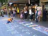 Melbourne / Swanston Street / Painting on the footpath, Swanston St between Collins St and Little Collins St