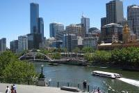 Melbourne / Yarra River at Flinders Walk / View from across Yarra River towards Evan Walker Bridge and Rialto Towers