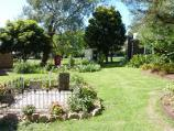 Moe / Gippsland Heritage Park, Lloyd Street / Garden and graves behind Holy Trinity Anglican church