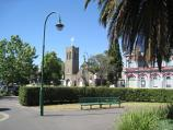 Moonee Ponds / Mount Alexander Road / View north from gardens in centre of Mt Alexander Rd towards St Thomas Anglican Church