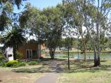 Moonee Ponds / Parkland along east bank of Maribyrnong River, north of Maribyrnong Road / View west across parkland towards Boathouse Cafe and river