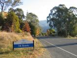 Mount Beauty / Bogong High Plains Road to Falls Creek / Town sign, view west along Bogong High Plains Rd near golf course