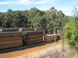 Noojee / Mount Baw Baw Road east of town / Wood stacks at timber mill near old Fumina Rd