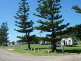 Seaspray / Foreshore Road through town centre / Seaspray Caravan Park, view north-east along Foreshore Rd towards Lyons St