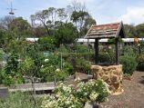 St Kilda / Veg Out Community Gardens, Shakespeare Grove / Wishing well amongst garden beds