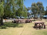 Tooradin / Landing Reserve picnic area fronting Sawtells Inlet, southern end of Foreshore Road / Tables and lawns