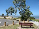 Tooradin / Landing Reserve picnic area fronting Sawtells Inlet, southern end of Foreshore Road / View south along foreshore from picnic area car park