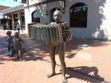 Werribee / Shops and commercial centre, Watton Street / Accordion Player & Shoppers sculpture outside Commercial Hotel, corner Watton St and Bridge St