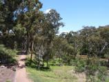 Werribee / Chirnside Park, Watton Street / View west along pathway beside Werribee River at north side of oval