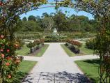 Werribee / Victoria State Rose Garden at Werribee Park, Werribee South / View from archway of roses towards rotunda