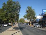 Wodonga / Shops along High Street south of railway line, Stanley Street and Woodland Grove / View south along High St between Elgin Bvd and Stanley St