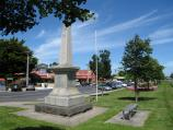 Yarragon / Commercial centre and shops, Princes Highway service road / War memorial, view west through gardens along service road towards Loch St