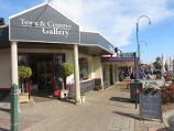 Yarragon / Commercial centre and shops, Princes Highway service road / Town & Country Gallery at entrance to the Village Walk